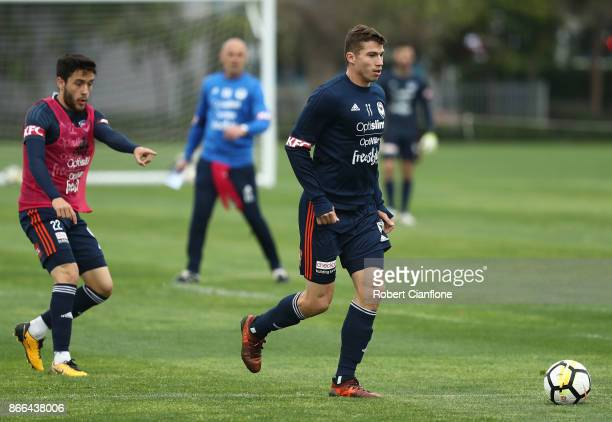 Mitch Austin of the Victory runs with the ball during a Melbourne Victory ALeague training session at Gosch's Paddock on October 26 2017 in Melbourne...