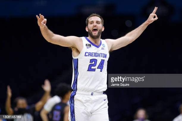 Mitch Ballock of the Creighton Bluejays reacts after a three point basket against the UC Santa Barbara Gauchos in the first round game of the 2021...