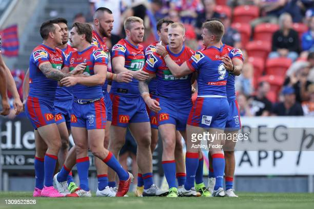 Mitch Barnett of the Knights celebrates his try with team mates during the round three NRL match between the Newcastle Knights and the Wests Tigers...