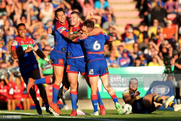 Mitch Barnett of the Newcastle Knights celebrates a try with team mates during the round 7 NRL match between the Newcastle Knights and Parramatta...