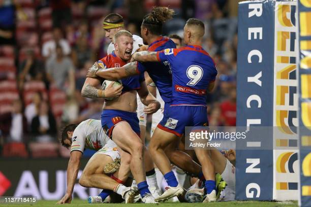 Mitch Barnett of the Newcastle Knights celebrates his try during the round two NRL match between the Newcastle Knights and the Penrith Panthers at...