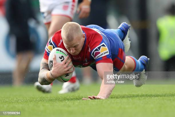 Mitch Barnett of the Newcastle Knights scores a try but given as no try during the round 19 NRL match between the Newcastle Knights and the St George...