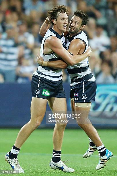 Mitch Brown and Jimmy Bartel of the Cats celebrate a goal during the round one AFL match between the Geelong Cats and the Adelaide Crows at Skilled...