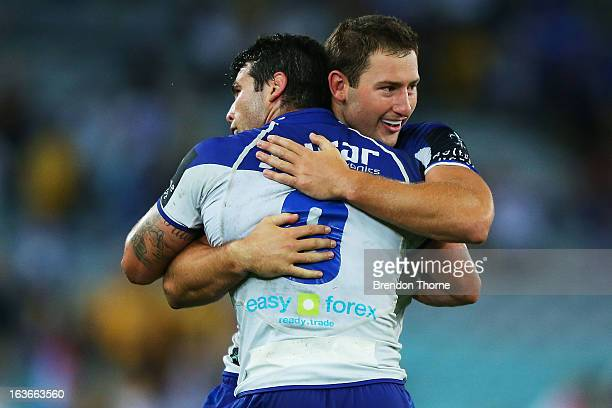 Mitch Brown and Michael Ennis of the Bulldogs celebrate at full time after victory over the Eels during the round two NRL match between the...