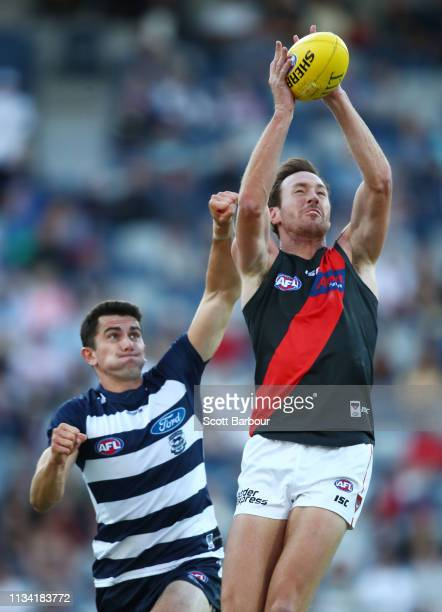 Mitch Brown of the Bombers and Jed Bews of the Cats compete for the ball during the 2019 JLT Community Series AFL match between the Geelong Cats and...