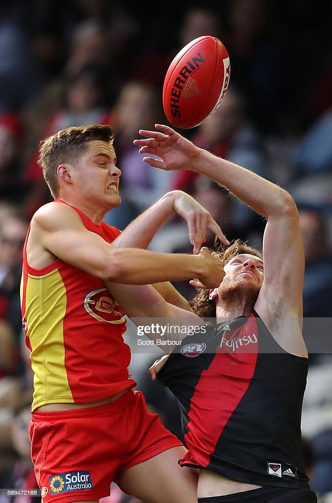 Mitch Brown of the Bombers and Kade Kolodjashnij of the Suns compete for the ball during the round 21 AFL match between the Essendon Bombers and the Gold Coast Suns at Etihad Stadium on August 14, 2016 in Melbourne, Australia.