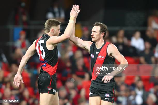 Mitch Brown of the Bombers celebrates a goal during the round 19 AFL match between the Gold Coast Suns and the Essendon Bombers at Metricon Stadium...