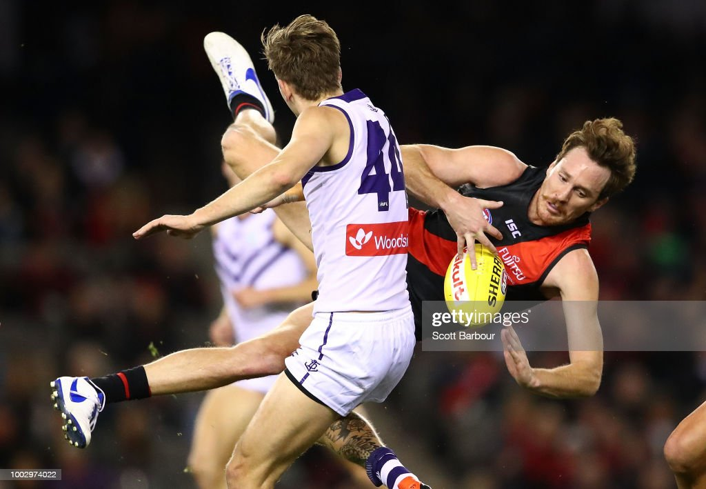 Mitch Brown of the Bombers competes for the ball during the round 18 AFL match between the Essendon Bombers and the Fremantle Dockers at Etihad Stadium on July 21, 2018 in Melbourne, Australia.