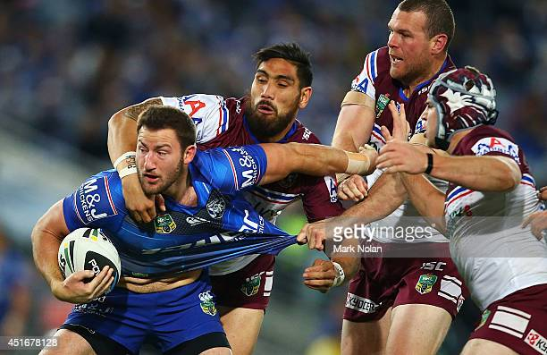 Mitch Brown of the Bulldogs makes a line break during the round 17 NRL match between the Canterbury Bulldogs and the Manly Sea Eagles at ANZ Stadium...