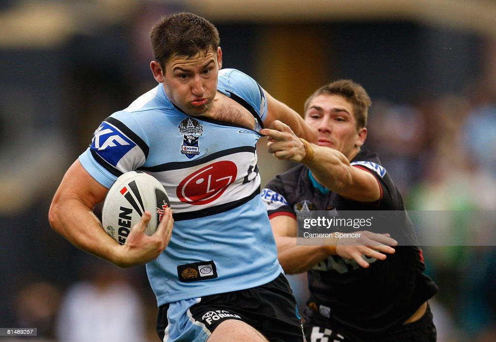 Mitch Brown of the Sharks is tackled during the round 13 NRL match between the Penrith Panthers and the Cronulla-Sutherland Sharks at CUA Stadium on June 8, 2008 in Sydney, Australia.