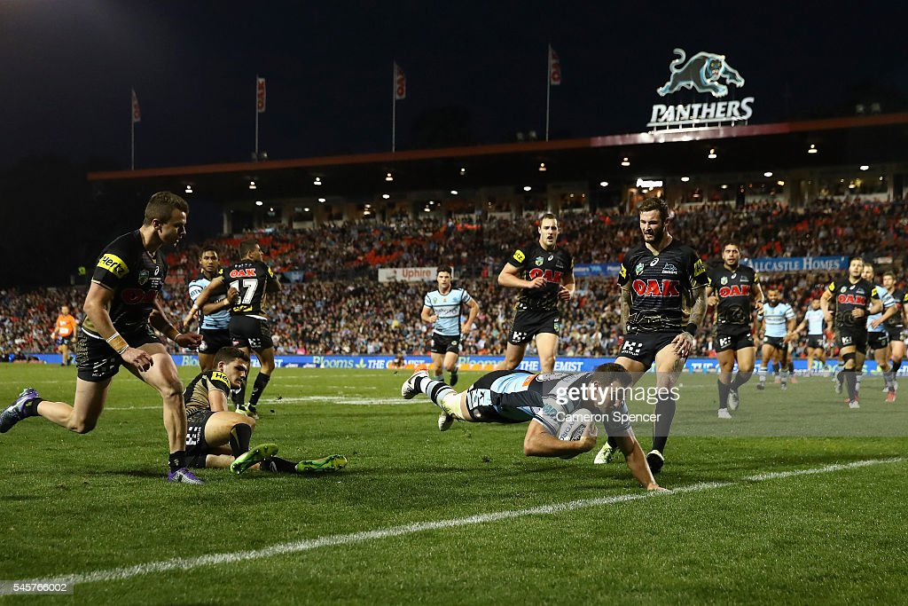 Mitch Brown of the Sharks scores a try during the round 18 NRL match between the Penrith Panthers and the Cronulla Sharks at Pepper Stadium on July 10, 2016 in Sydney, Australia.