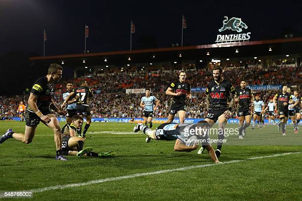 Mitch Brown of the Sharks scores a try during the round 18 NRL match between the Penrith Panthers and the Cronulla Sharks at Pepper Stadium on July...