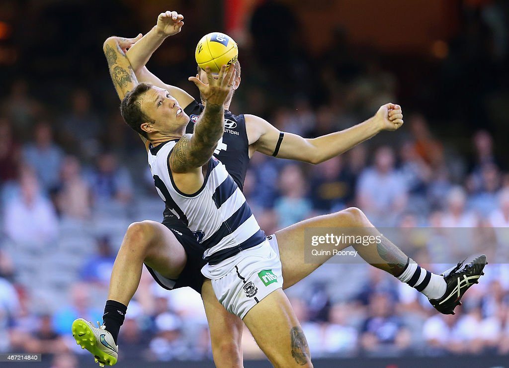 Mitch Clark of the Cats marks infront of Kristian Jaksch of the Blues during the NAB Challenge AFL match between the Carlton Blues and the Geelong Cats at Etihad Stadium on March 22, 2015 in Melbourne, Australia.