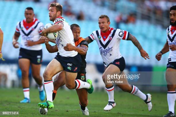 Mitch Cornish of the Roosters is tackled during the round one NRL match between the Wests Tigers and the Sydney Roosters at ANZ Stadium on March 10...