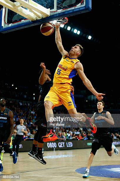 Mitch Creek of Adelaide slams the ball during game one of the NBL Finals series between the New Zealand Breakers and the Adelaide 36ers at Vector...