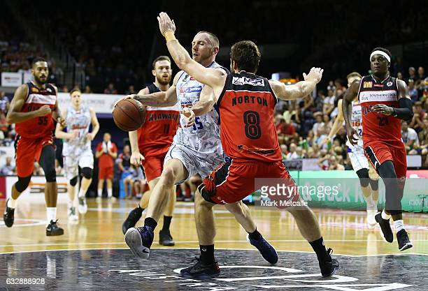 Mitch Creek of the 36ers drives at Mitch Norton of the Hawks during the round 17 NBL match between the Illawarra Hawks and the Adelaide 36ers at WIN...