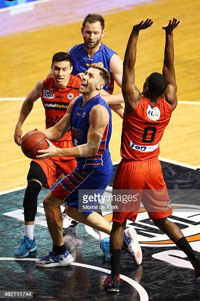 Mitch Creek of the 36ers goes for the basket while under pressure from Jermaine Beale of the Wildcats during the round one NBL match between Adelaide...