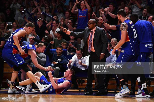 Mitch Creek of the Adelaide 36ers and Joey Wright head coach of the Adelaide 36ers react after receiving a foul in the final seconds during the round...