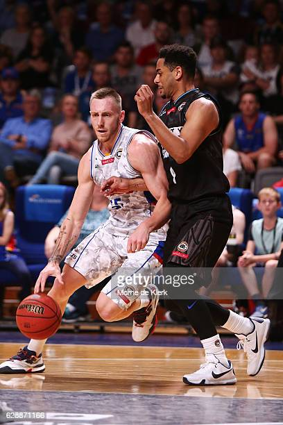 Mitch Creek of the Adelaide 36ers competes with Corey Webster of the New Zealand Breakers during the round 10 NBL match between the Adelaide 36ers...