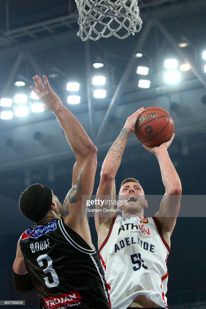Mitch Creek of the Adelaide 36ers (R) drives at the basket under pressure from Josh Boone of Melbourne United during game one of the NBL Grand Final series between Melbourne United and the Adelaide 36ers at Hisense Arena on March 16, 2018 in Melbourne, Australia.