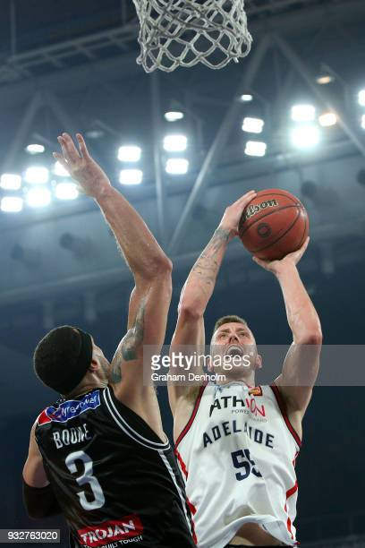 Mitch Creek of the Adelaide 36ers drives at the basket under pressure from Josh Boone of Melbourne United during game one of the NBL Grand Final...
