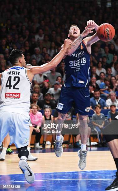 Mitch Creek of the Adelaide 36ers gets fouled bby Tai Wesley of Melbourne United during game four of the NBL Grand Final series between the Adelaide...