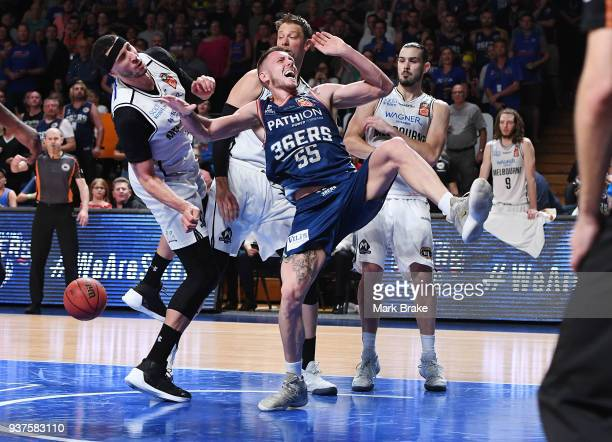 Mitch Creek of the Adelaide 36ers gets fouled in the last minutes during game four of the NBL Grand Final series between the Adelaide 36ers and...