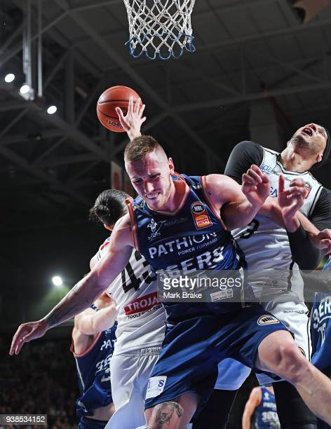 Mitch Creek of the Adelaide 36ers is bumped by Josh Boone of Melbourne United during game four of the NBL Grand Final series between the Adelaide...