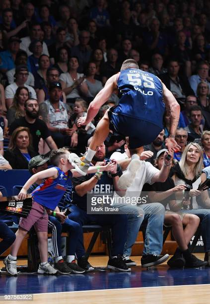 Mitch Creek of the Adelaide 36ers lands in the crowd cahsing a pass during game four of the NBL Grand Final series between the Adelaide 36ers and...