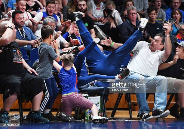 Mitch Creek of the Adelaide 36ers lands in the crowd chasing a pass during game four of the NBL Grand Final series between the Adelaide 36ers and...