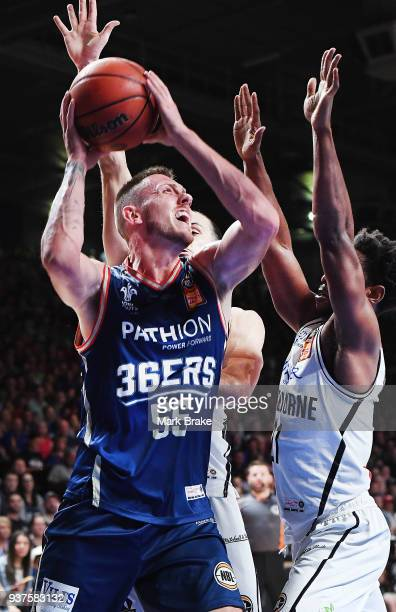 Mitch Creek of the Adelaide 36ers looks to shoot blocked by Casper Ware of Melbourne United during game four of the NBL Grand Final series between...