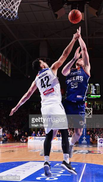 Mitch Creek of the Adelaide 36ers shoots over Tai Wesley of Melbourne United during game four of the NBL Grand Final series between the Adelaide...