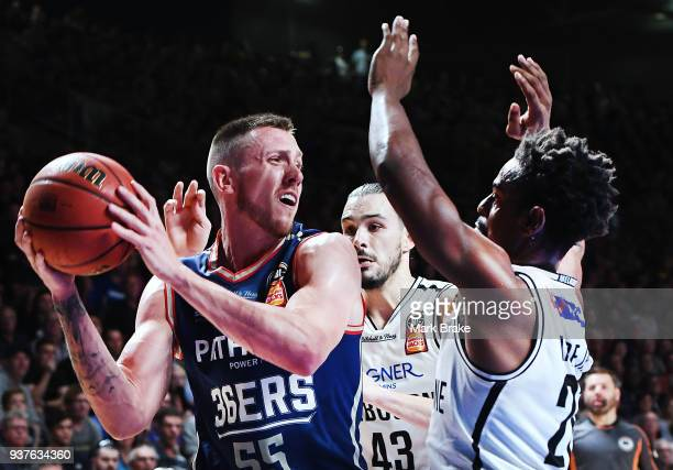 Mitch Creek of the Adelaide 36ers under pressure from Casper Ware of Melbourne United during game four of the NBL Grand Final series between the...