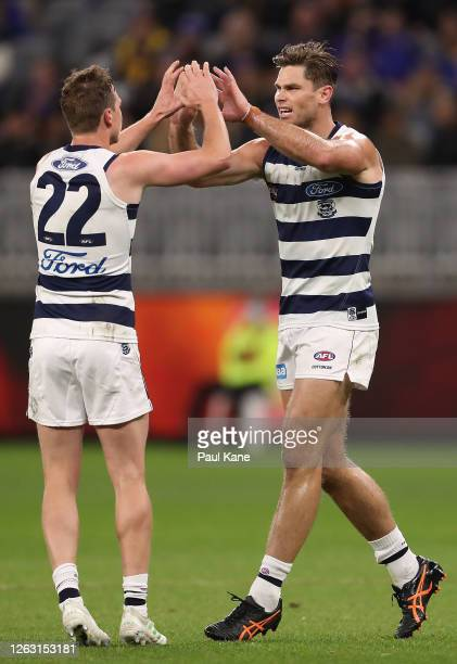 Mitch Duncan and Tom Hawkins of the Cats celebrate a goal during the round nine AFL match between West Coast Eagles and the Geelong Cats at Optus...