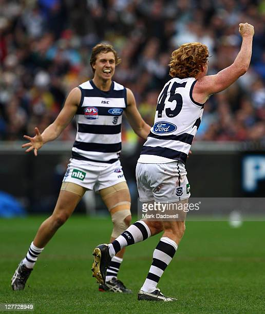 Mitch Duncan celebrates with Cameron Ling of the Cats during the 2011 AFL Grand Final match between the Collingwood Magpies and the Geelong Cats at...