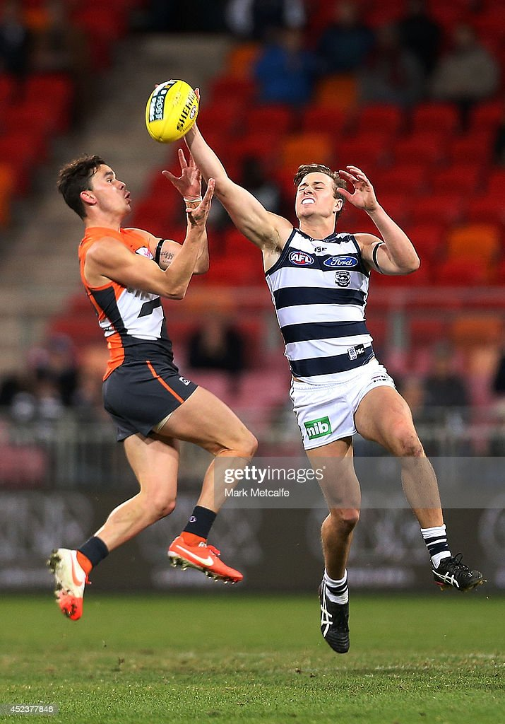 Mitch Duncan of the Cats competes for the ball against Zachary Williams of the Giants during the round 18 AFL match between the Greater Western Sydney Giants and the Geelong Cats at Spotless Stadium on July 19, 2014 in Sydney, Australia.