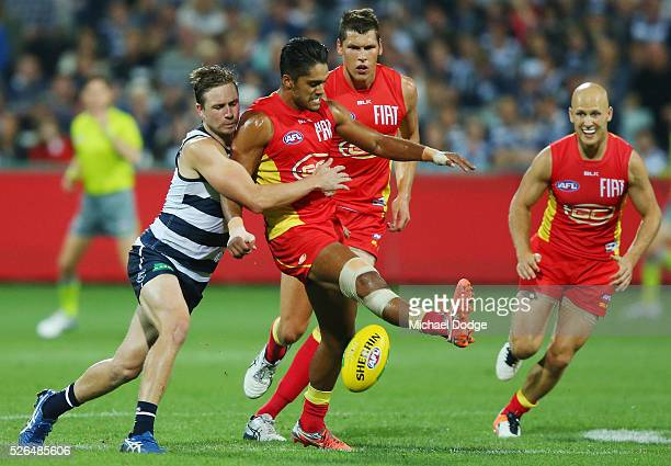 Mitch Duncan of the Cats tackles Aaron Hall of the Suns during the round six AFL match between the Geelong Cats and the Gold Coast Suns at Simonds...