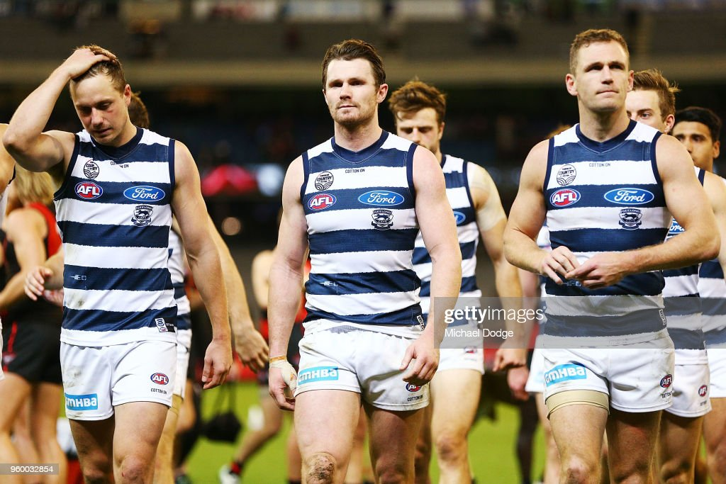 Mitch Duncan (L) Patrick Dangerfield and Joel Selwood (R) lead the team off after defeat during the round nine AFL match between the Essendon Bombers and the Geelong Cats at Melbourne Cricket Ground on May 19, 2018 in Melbourne, Australia.
