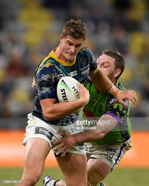 Mitch Dunn of the Cowboys is tackled during the round 12 NRL match between the North Queensland Cowboys and the Canberra Raiders at QCB Stadium on...