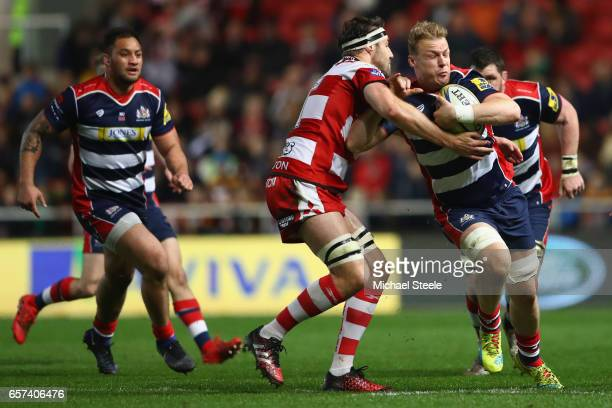 Mitch Eadie of Bristol is held up by Jeremy Thrush of Gloucester during the Aviva Premiership match between Bristol Rugby and Gloucester Rugby at...