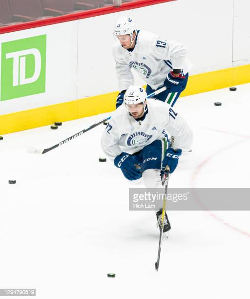 Mitch Eliot and Jayce Hawryluk of the Vancouver Canucks skate on the first day of the Vancouver Canucks NHL Training Camp on January 2021 at Rogers...
