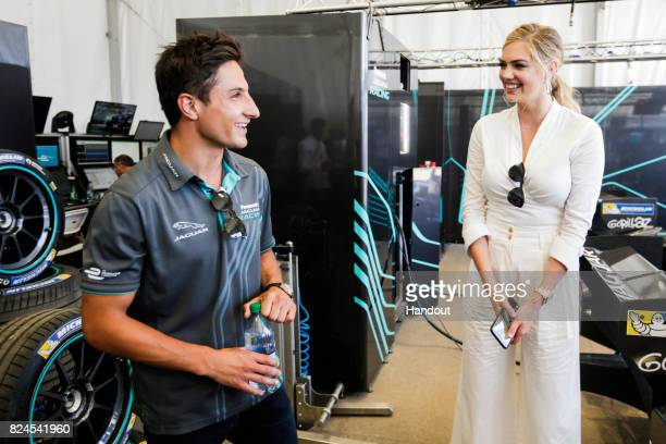 Mitch Evans and Kate Upton in the Panasonic Jaguar Racing garage during the Montreal ePrix twelfth round of the 2016/17 FIA Formula E Series on July...