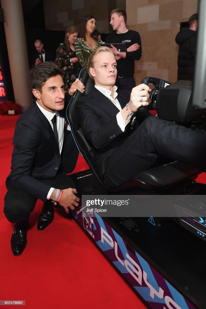 Mitch Evans (L) and Marius Borg Hoiby compete on the Formula E Simulator at the BRITS official aftershow party, in partnership with Tempus Magazine, at the Intercontinental London - The O2 on February 21, 2018 in London, England