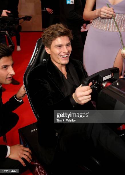 Mitch Evans and Oliver Cheshire compete on the Formula E Simulators at the BRITS official aftershow party in partnership with Tempus Magazine at the...