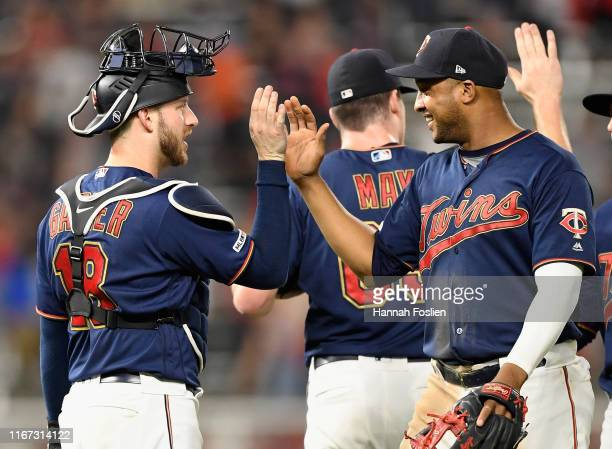 Mitch Garver and Jonathan Schoop of the Minnesota Twins celebrate defeating the Washington Nationals after the interleague game at Target Field on...