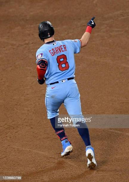 Mitch Garver of the Minnesota Twins celebrates as he rounds the bases after hitting a solo home run against the Detroit Tigers during the fourth...