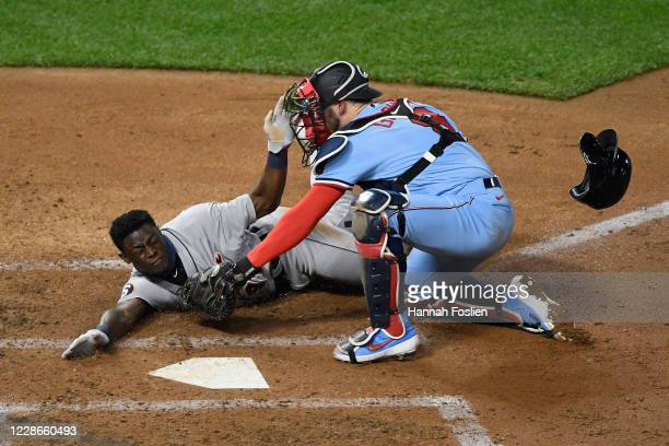 Mitch Garver of the Minnesota Twins defends home plate from Daz Cameron of the Detroit Tigers during the fifth inning of the game at Target Field on...