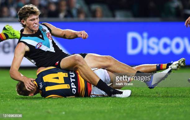 Mitch Georgiades of Port Adelaide lands on David Mackay of the Crows during the round eight AFL match between the Port Adelaide Power and the...