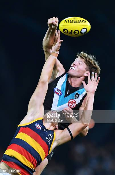 Mitch Georgiades of Port Adelaide spoils Tom Doedee of the Crows during the round eight AFL match between the Port Adelaide Power and the Adelaide...
