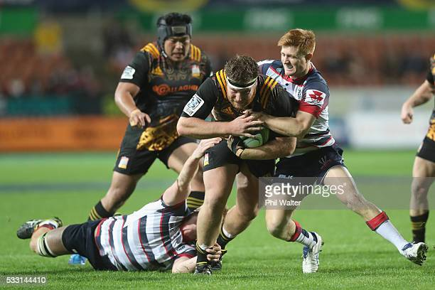 Mitch Graham of the Chiefs is tackled during the round 13 Super Rugby match between the Chiefs and the Rebels at FMG Stadium on May 21 2016 in...